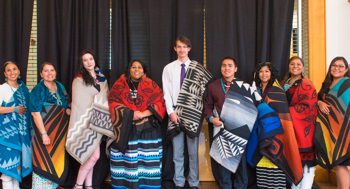 native americans with traditional blankets