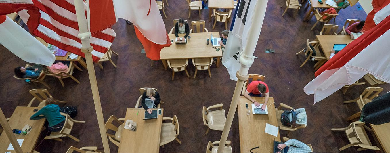 overhead view of people studying in the library with flags in the foreground